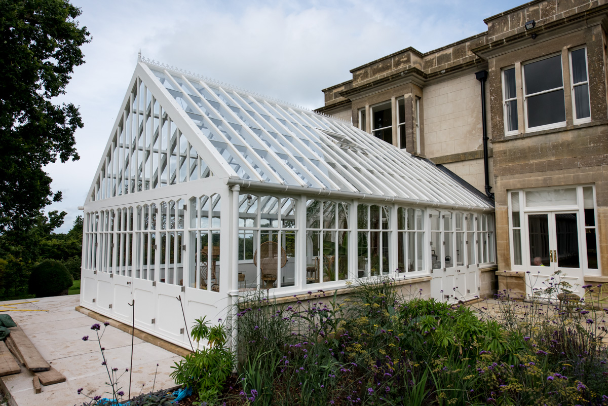 Exterior of white timber conservatory available in Bath and the South West
